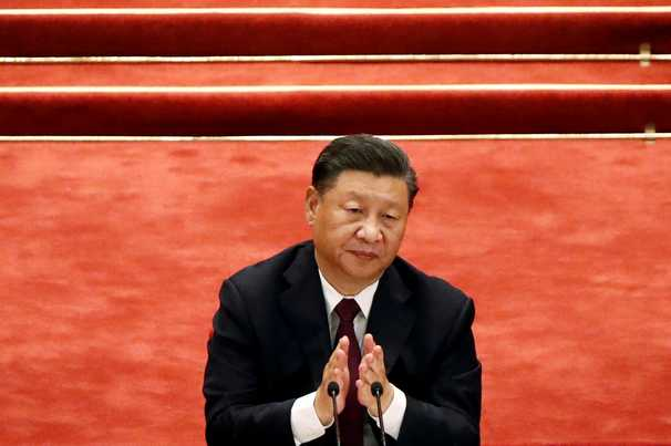 A year after coronavirus emerged in Wuhan, China's Xi declares 2020 a triumph