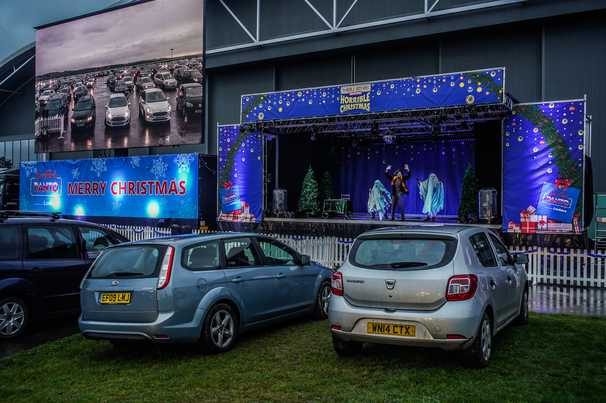 Britain's holiday tradition of outrageous pantomime theater has a pandemic plot twist: Drive-in shows
