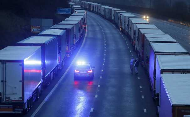 Travel resumes across the English Channel, but backlog of trucks will take days to resolve