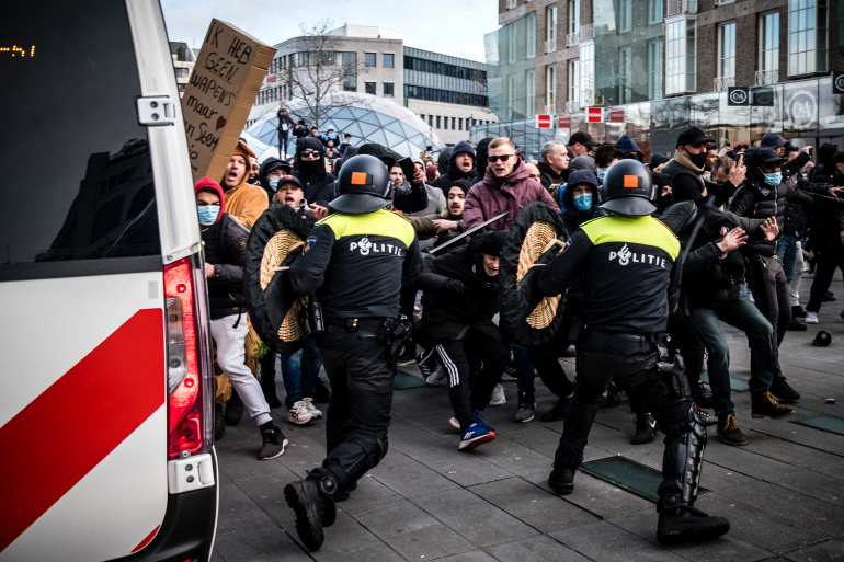 Dutch police clash with anti-lockdown rioters in two cities
