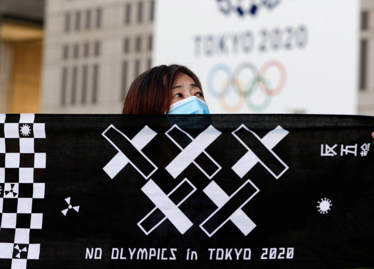 Japan's Suga insists delayed Tokyo Olympics will go ahead in 2021