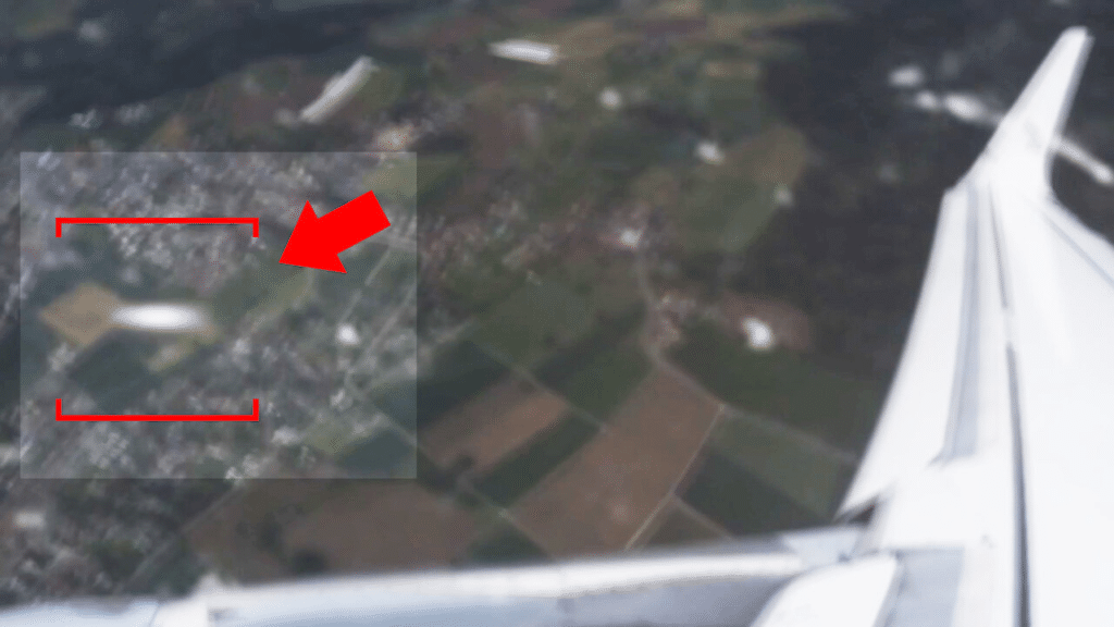 Near Collision with UFO Recorded on Video by a Plane Passenger