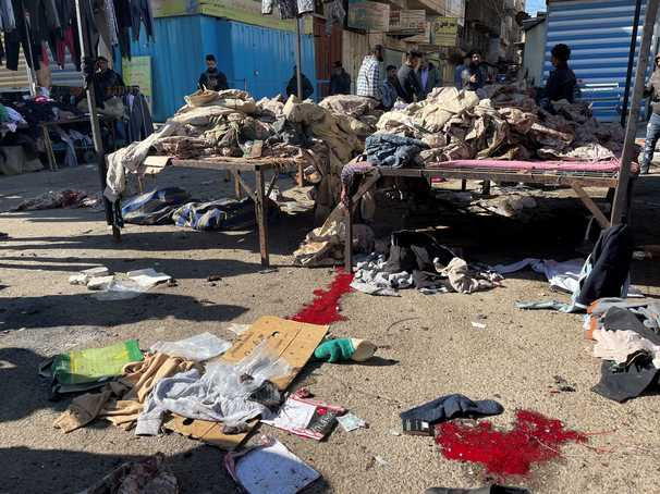 Rare twin suicide bombings rock Baghdad market, killing at least 28