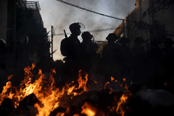 Violence erupts in Israel's ultra-Orthodox neighborhoods over covid restrictions