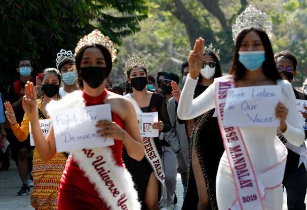 Bathtubs, wedding gowns and dinosaurs: Demonstrations against military rule in Myanmar get creative