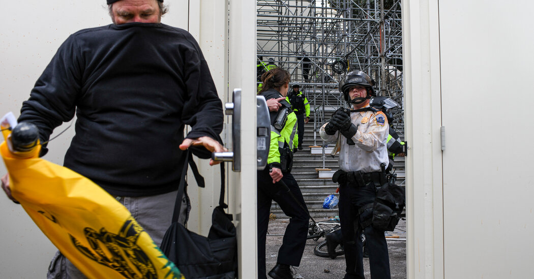 Officers' Injuries, Including Concussions, Show Scope of Violence at Capitol Riot