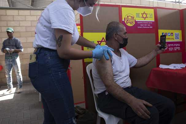 After delays and ethics debates, Israel begins vaccinating 100,000 Palestinian day laborers
