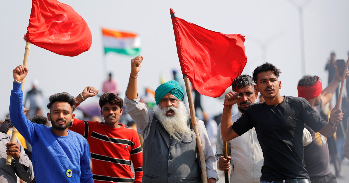 India: Farmers mark 100th day of protest, block highway