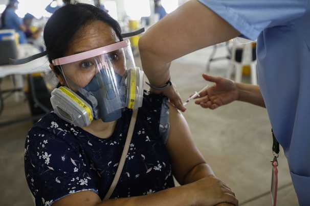 Live updates: Global coronavirus numbers edging back up after weeks of decline, says WHO