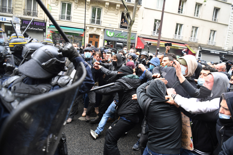 France: Scuffles and arrests in Paris as thousands mark May Day