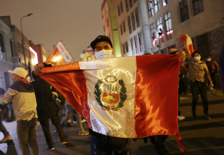 Deeply divided Peru awaits final results of presidential vote